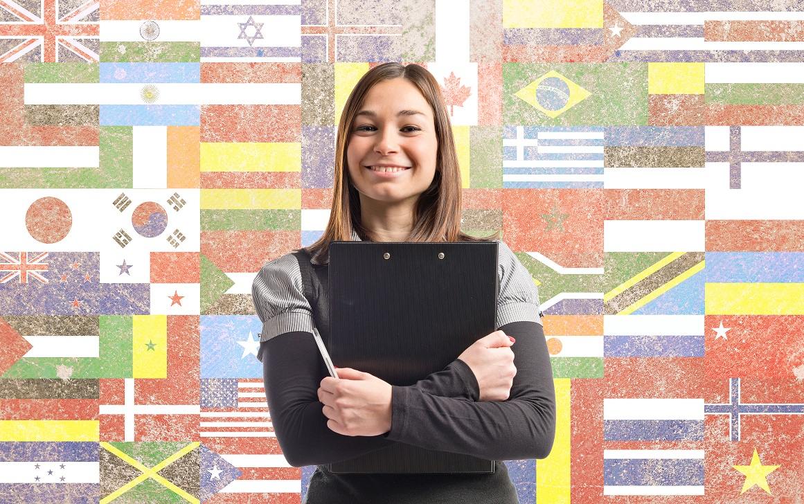 Young pretty student over flags background