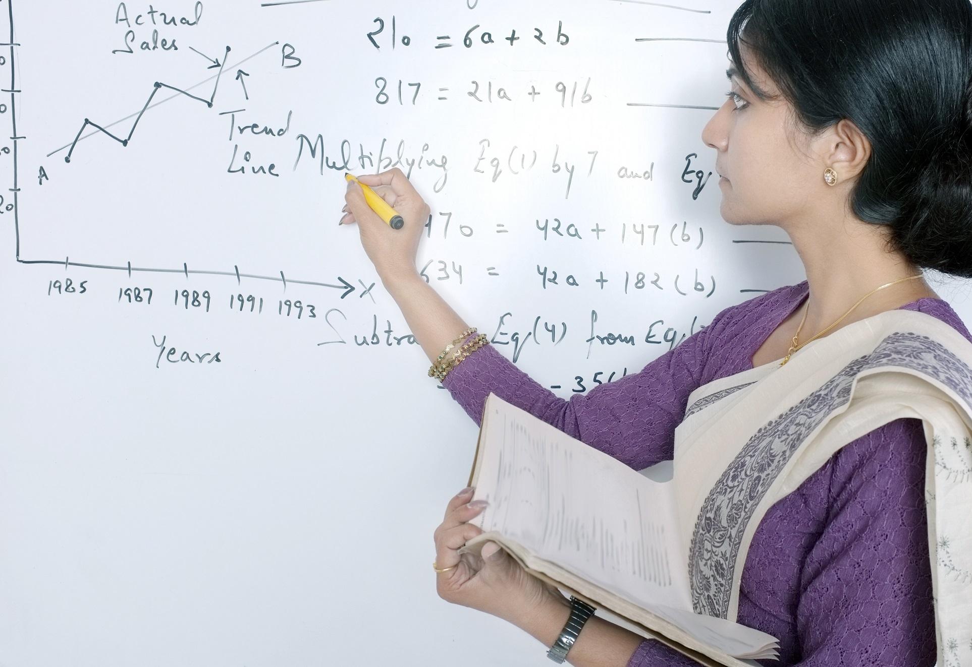 Indian professor doing an equation