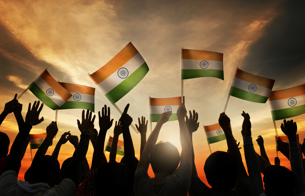 People waving Indian flags