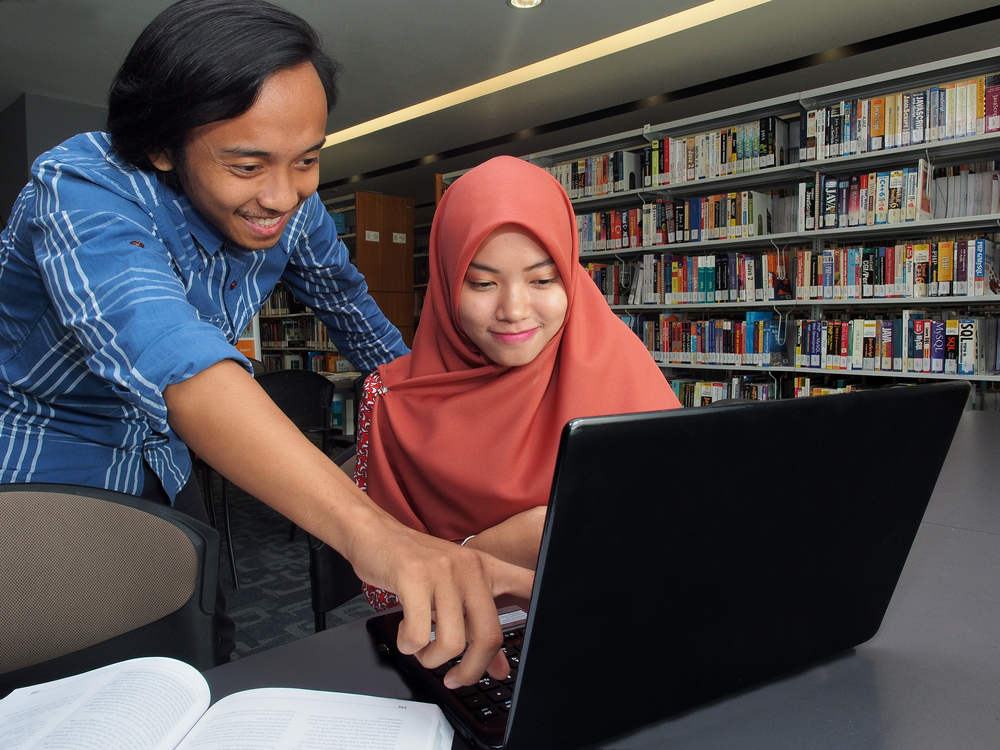 Two Malaysian students studying