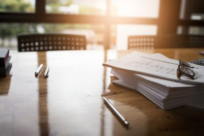 Papers on a office desk during a sunrise